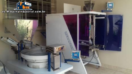 Máquina empacadora y pesadora JHM